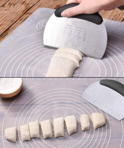 Baker's blade is being used to cut the dough